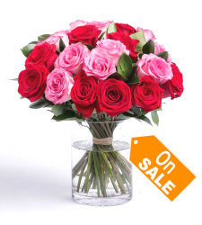send 24 red and pink color roses in vase to cebu